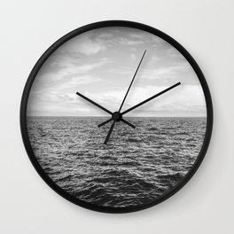 Flat horizon of the sea with smooth waves in black and white Wall Clock