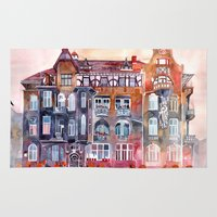 takmaj Area & Throw Rugs featuring Apartment House in Poznan and orange umbrellas by takmaj