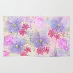 Painterly purple pansies and pink Oxalis Rug