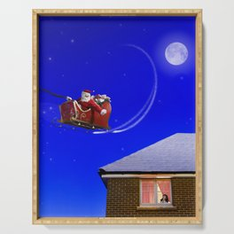 Young girl watching Santa Claus fly over her house Serving Tray