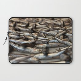 small silvery fish put on display to be sold. Fishes in the foreground and in the background unfocus Laptop Sleeve