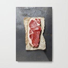 Raw beef steak on a dark slate background Metal Print
