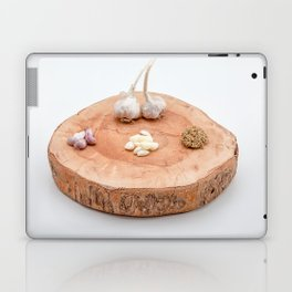 on a wooden plank lies garlic mashed as well as knoll Laptop & iPad Skin