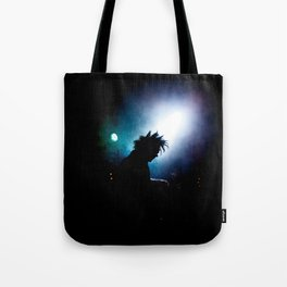 silhouette of a punk rock artist in the spotlight Tote Bag