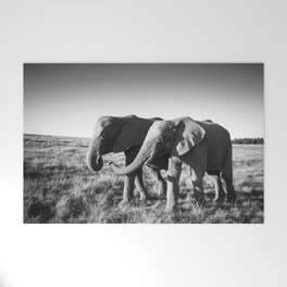 Elephant friends walk together along African savanna Welcome Mat