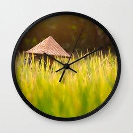 Woman working in golden green rice paddy in Bali, Indonesia Wall Clock