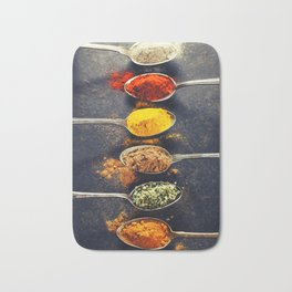 Colorful spices in metal spoons Bath Mat