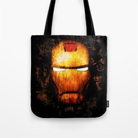 iron man Tote Bags featuring Iron Man by Sirenphotos