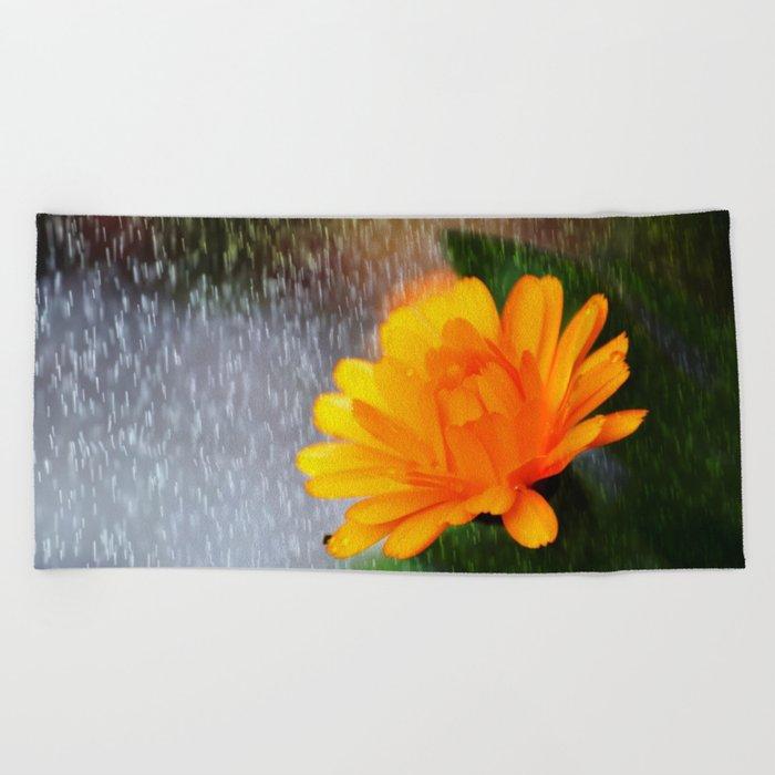 Golden flower on a rainy day Beach Towel