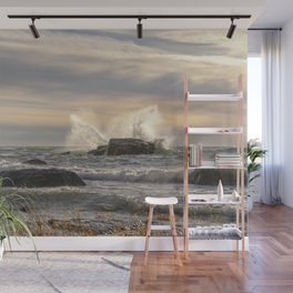 Waves splash crashing against rocks Wall Mural