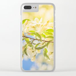 Macro shot of bird cherry blossom over blue sky Clear iPhone Case
