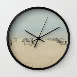 zebras in the morning light Wall Clock
