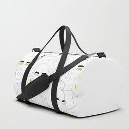 In Mustard Duffle Bag