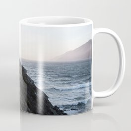 PERSON STANDING ON ROCK CLIFF NEAR BODY OF WATER Coffee Mug