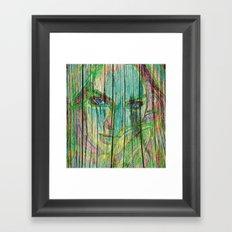 Woman on wood Framed Art Print