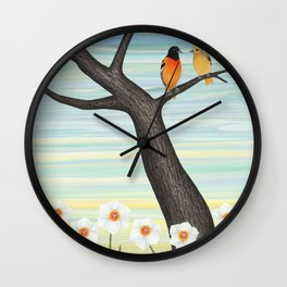 Orioles and daffodils Wall Clock
