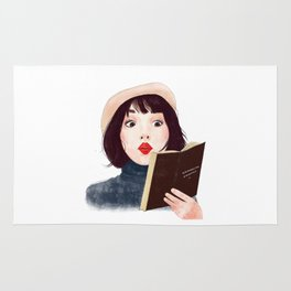 French woman with book Rug