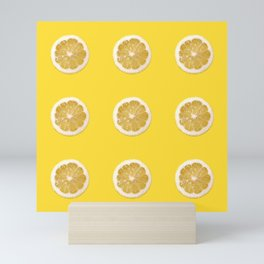 Cropped lemon pattern on yellow background Mini Art Print
