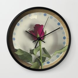 Red rose on a plate Wall Clock