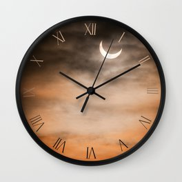 Partial solar eclipse through the clouds Wall Clock