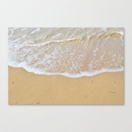 Beautiful wave surfing on a sandy beach Canvas Print