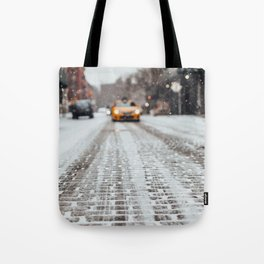 Yellow cab during snow Tote Bag