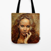 jennifer lawrence Tote Bags featuring Portrait of Jennifer Lawrence by André Joseph Martin