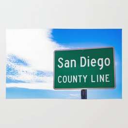 Closeup of the San Diego County Line Sign against a Blue Sky in the Anza Borrego Desert State Park Rug