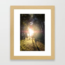 Woman hiking along an Oregon forest trail at sunset Framed Art Print
