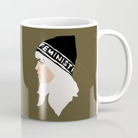 feminist Mugs featuring Feminist (Gold) by Anna McKay