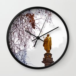 Statue of a saint in gold Wall Clock