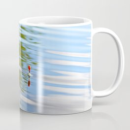 Fishing float on the water Coffee Mug