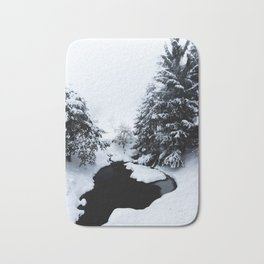 Snowy pond and trees disappearing in fog Bath Mat