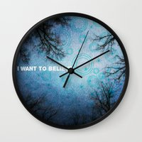 i want to believe Wall Clocks featuring I want to believe... by Julia Kovtunyak