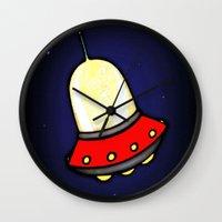 spaceship Wall Clocks featuring Spaceship by Caroline Blicq