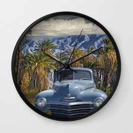 Vintage Blue Plymouth Automobile against Palm Trees and Cloudy Blue Sky near Palm Springs California Wall Clock