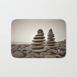 Stone pyramid symbolizing zen, harmony, balance. Bath Mat