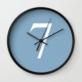 number seven sign on placid blue color background Wall Clock