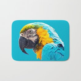 Macaw portrait on a turquoise background Bath Mat