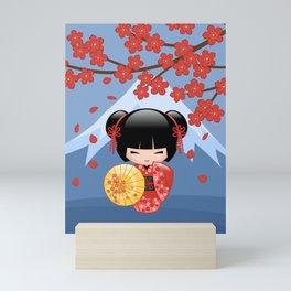 Japanese Red Sakura Kokeshi Doll on Blue Mini Art Print