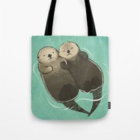 otters Tote Bags featuring Significant Otters - Otters Holding Hands by StudioMarimo