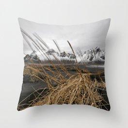 Mountain range behind black sand dunes Throw Pillow