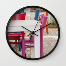 Colorful chairs and white tables Wall Clock