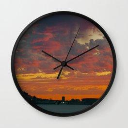 green point sunset Wall Clock