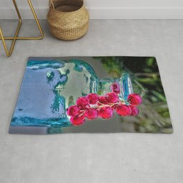 Summer colors- vintage bottle and red currant berries Rug