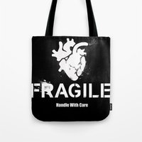 anatomical heart Tote Bags featuring Fragile Anatomical Heart(INVERT) by J ō v