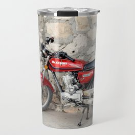 Motorbike red parked by the cement wall Travel Mug