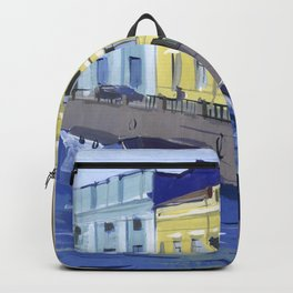 Cityscape of the embankment of the pavement with the river channel. Backpack