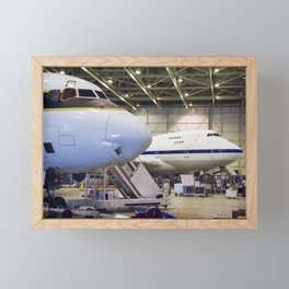 The cavernous expanse of the Dryden Aircraft Operations Facility in Palmdale Calif now houses NASAs Framed Mini Art Print