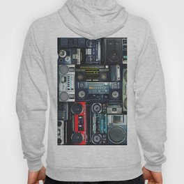 Pattern of retro old hipster music audio tape recorders from the 70s, 80s, 90s, 2000s, background. Hoody